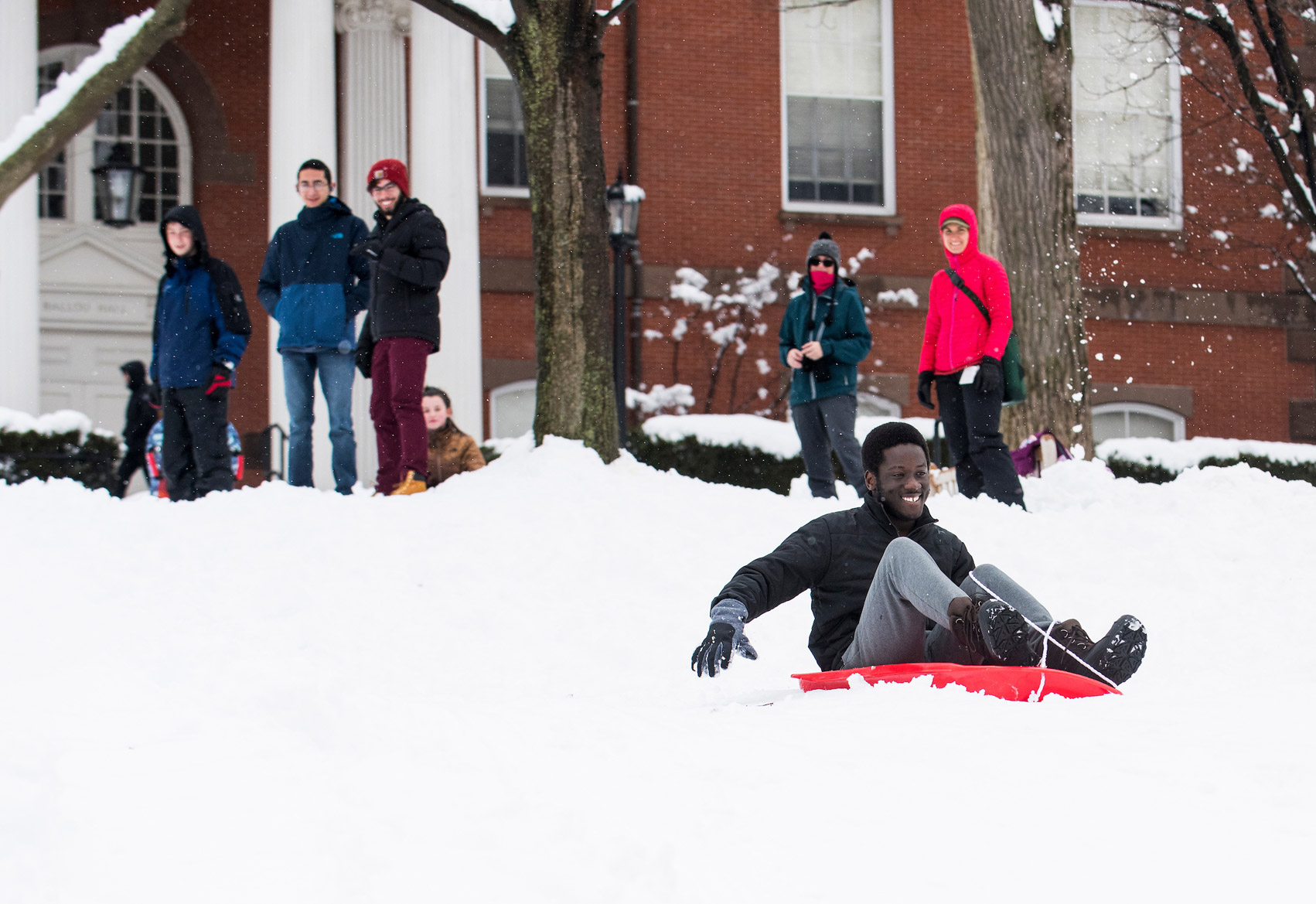 Sledding during winter term at Tufts